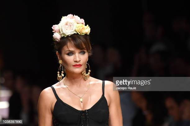 Helena Christensen walks the runway at the Dolce Gabbana show during Milan Fashion Week Spring/Summer 2019 on September 23 2018 in Milan Italy