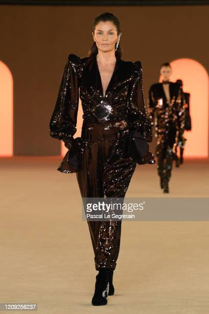 Helena Christensen walks the runway during the Balmain show as part of the Paris Fashion Week Womenswear Fall/Winter 2020/2021 on February 28, 2020...