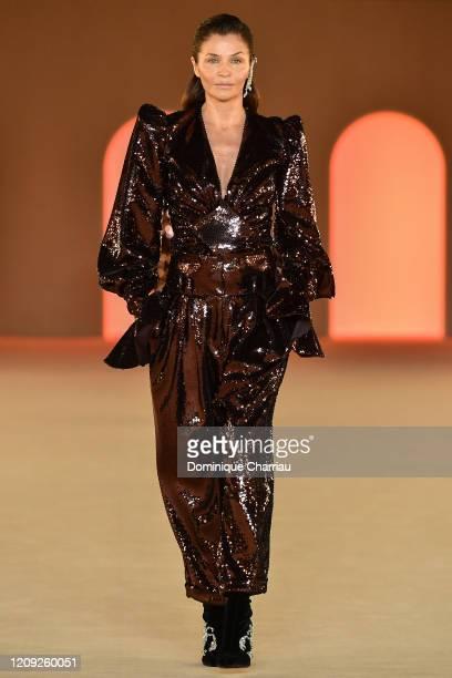 Helena Christensen walks the runway during the Balmain show as part of the Paris Fashion Week Womenswear Fall/Winter 2020/2021 on February 28, 2020...