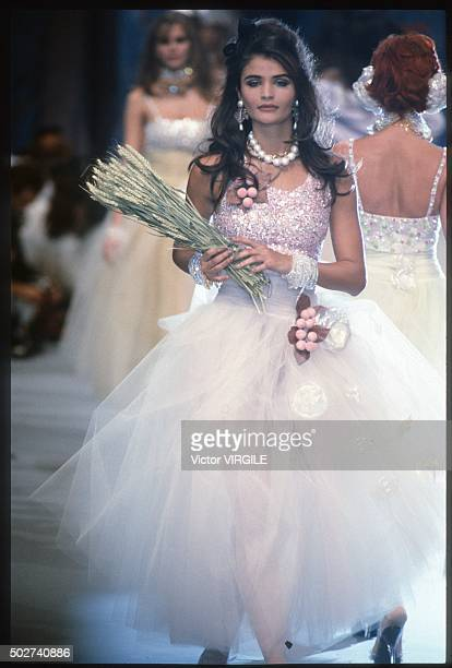 Helena Christensen walks the runway during the Chanel Ready to Wear show as part of Paris Fashion Week Spring/Summer 19921993 in October 1992 in...