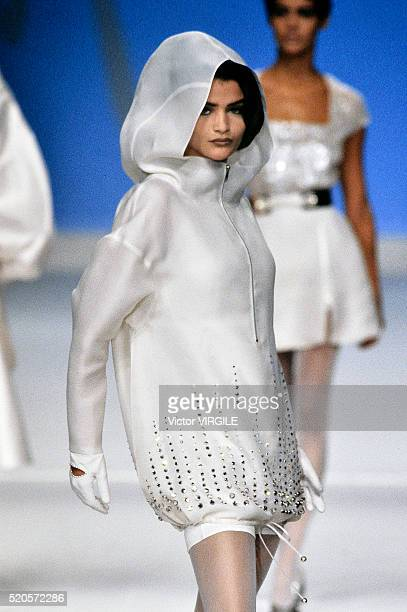Helena Christensen walks the runway during the Claude Montana Ready to Wear show as part of Paris Fashion Week Spring/Summer 19911992 in October 1991...