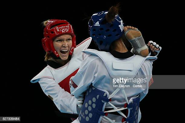 Helena Fromm, Germany, on her way to victory over Hoang Dieu Linh Chu, Vietnam, during the Taekwondo Women 67kg preliminary round during the London...