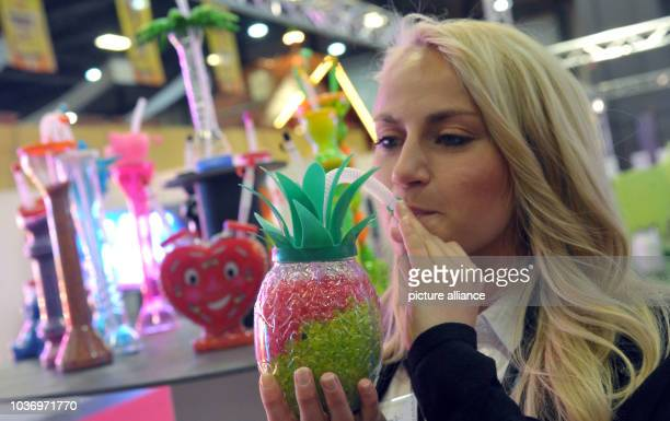 Helena Gretzinger drinking slush ice from a plastic pineapple on the Messe fair ground where the Interschau Schaustellermesse is taking place until...