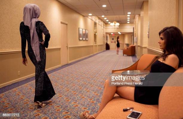 Helena Higgins right a Miss Maine USA contestant from Belfast watches Hamdia Ahmed practice her pageant walk in the hallway and offers her tips...