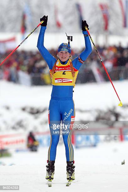 Helena Jonsson of Sweden celebrates after crossing the finish line winning the Women's 10 km Pursuit in the IBU Biathlon World Cup on December 12,...