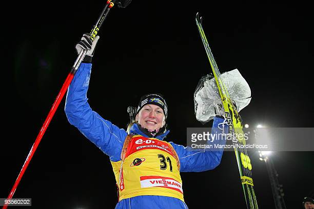 Helena Jonsson of Sweden celebrates after winning the Women's 15 km Individual event in the EON Ruhrgas IBU Biathlon World Cup on December 2 2009 in...