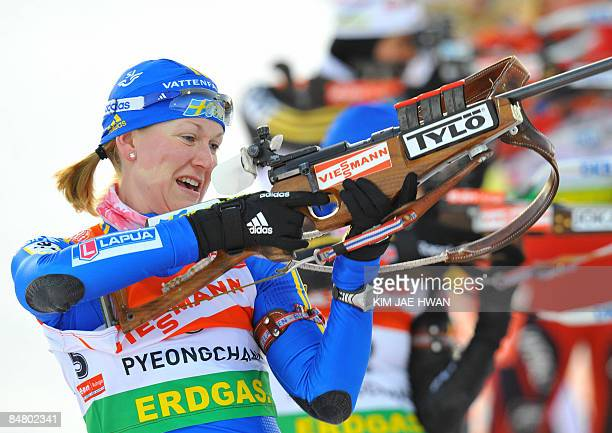 Helena Jonsson of Sweden shoots during the women's 10 km pursuit event at the IBU World Biathlon Championships in Pyeongchang, east of Seoul, on...