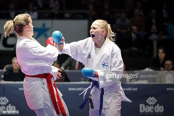 Helena Kuusisto of Finland vies against Croatia's Anamarija Celan Bujas during the Karate European Championships 2014 on May 3 2014 in Tampere...