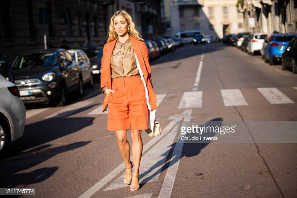 Helena Lunardelli, wearing an orange blazer with matching shorts, brown printed shirt, nude sandals and beige bag, is seen outside Salvatore...