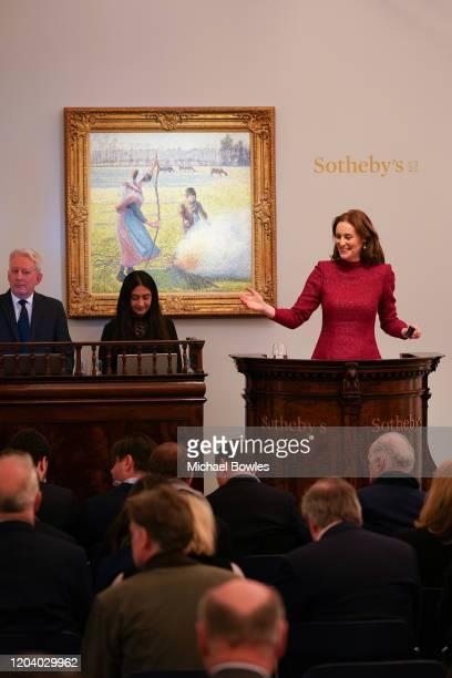 Helena Newman Sotheby's European Chairman fields bids during the sale of Camille Pissarro's 'Gelée blanche jeune paysanne faisant du feu' which sold...