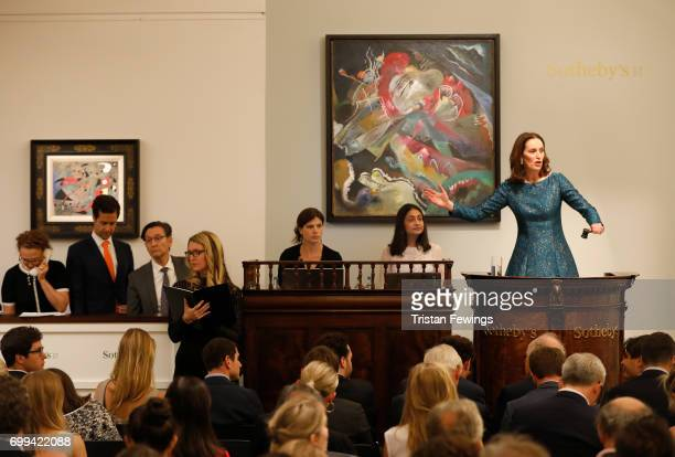 Helena Newman SothebyÕs European Chairman fields bids during the sale of KandinskyÕs Painting with White Lines which finally sold for GBP 33 million...