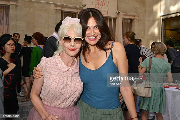 Helena Noguerra and Fifi Chachnil attend the Fifi Chachnil 'Grand Escalier' show as part of Paris Fashion Week Haute Couture Fall/Winter 2015/2016 on...