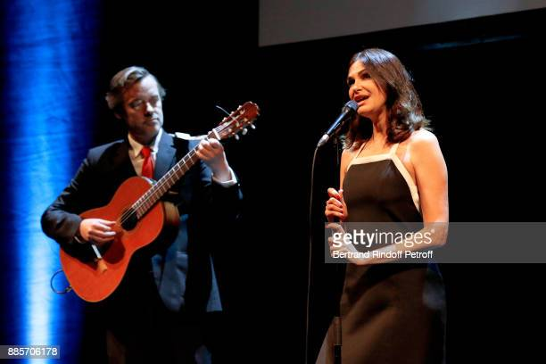 Helena Noguerra sings the song 'On dit que je ne suis pas sage' Lyrics by Jeanne Moreau accompanied by the guitarist Philippe Eveno during the...