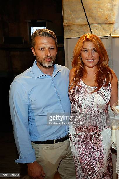 Helena Paparizou and guest pose after the 'Nana Mouskouri Birthday Tour' In Herod Atticus Odeon Theatre on July 14 2014 in Athens Greece
