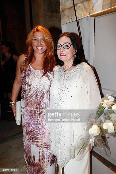 Helena Paparizou and Nana Mouskouri pose after the 'Nana Mouskouri Birthday Tour' In Herod Atticus Odeon Theatre on July 14 2014 in Athens Greece