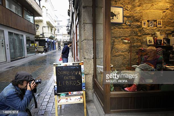 Helena Pinto reads a book untilted 'End This Depression Now' by Paul Krugman in a bookstore in Coruna northwestern Spain on June 15 in an attemp to...