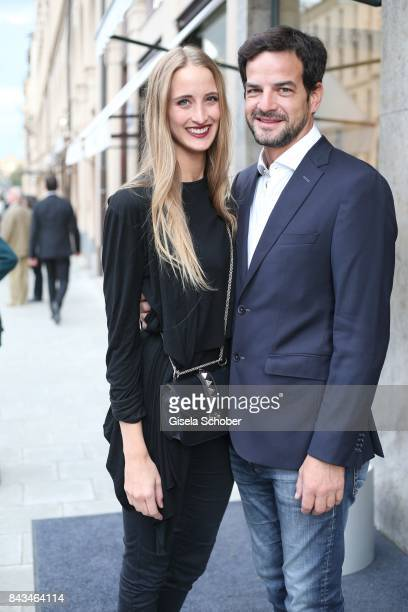 Helena Schoeller and her fiance Juan Martin Sarli during the Brunello Cucinelli Cocktail on September 6 2017 in Munich Germany
