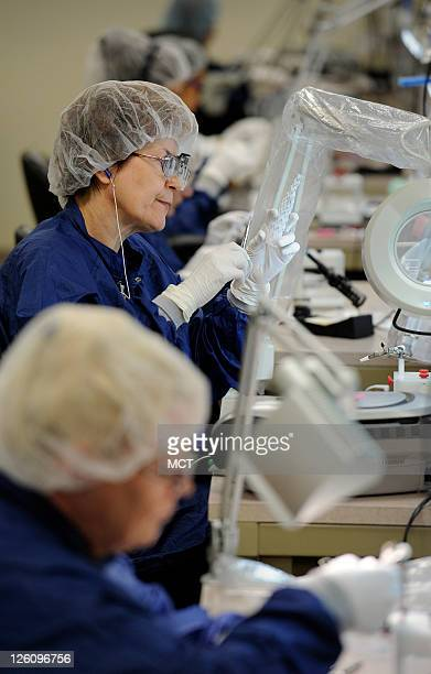 Helena Zuk attaches a stent body to the graft material of a Zenith AAA flex stent at Cook Medical in Bloomington, Indiana, September 20, 2011. The...