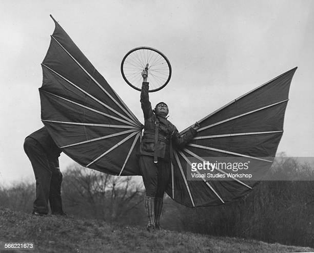 Helene Alberti, poised on a knoll on the Anderson estate, ready to start off on a brief swoop, aided by her bat-like wings and further assisted by...