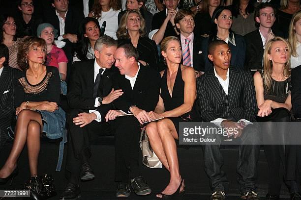 Helene Arnault, Bernard Arnault, Richard Prince, his wife William Farrel and Delphine Arnaultattends the Louis Vuitton fashion show, during the...