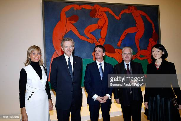 Helene Arnault, her husband Owner of LVMH Luxury Group Bernard Arnault, French Prime Minister Manuel Valls, Hermitage director Mikhail Piotrovsky and...