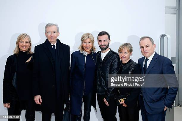 Helene Arnault her husband Owner of LVMH Luxury Group Bernard Arnault Miss Emmanuel Macron Stylist Nicolas Ghesquiere Brigitte Burke and her husband...