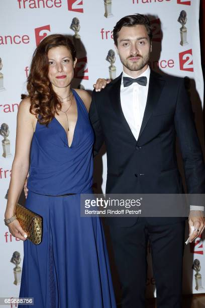 "Helene Degy and Simon Larvaron attend ""La Nuit des Molieres 2017"" at Folies Bergeres on May 29, 2017 in Paris, France."