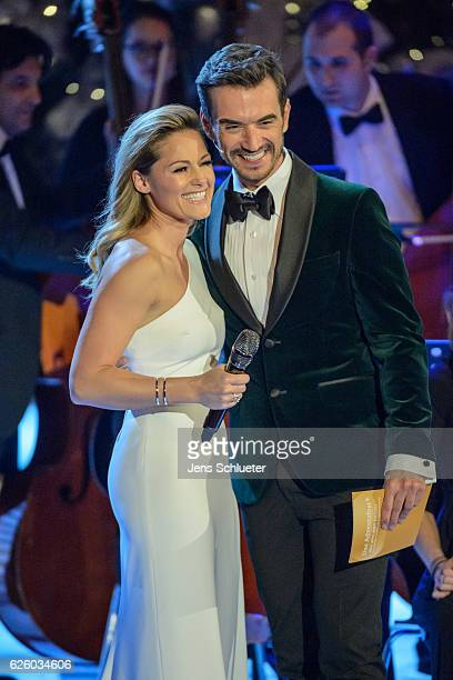 Helene Fischer and Florian Silbereisen are seen on stage during the tv show 'Das Adventsfest der 100000 Lichter' on November 26 2016 in Suhl Germany