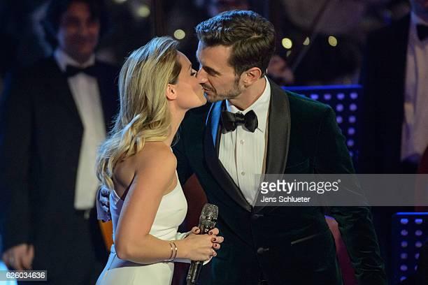 Helene Fischer and Florian Silbereisen are seen on stage during the tv show 'Das Adventsfest der 100.000 Lichter' on November 26, 2016 in Suhl,...