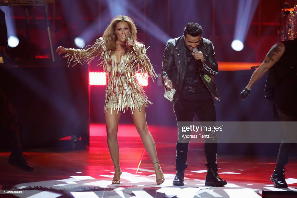 Helene Fischer and Luis Fonsi perform on stage during the Echo Award show at Messe Berlin on April 12, 2018 in Berlin, Germany.