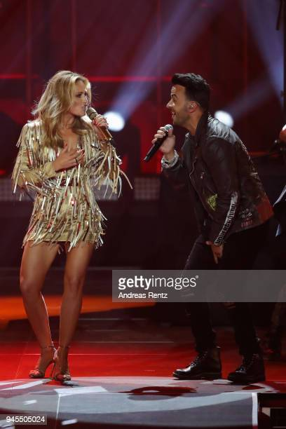 Helene Fischer and Luis Fonsi perform on stage during the Echo Award show at Messe Berlin on April 12 2018 in Berlin Germany