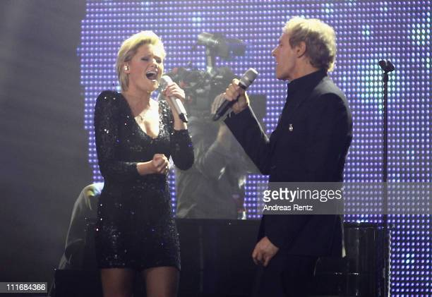 Helene Fischer and Michael Bolton perform on stage during the 'Deutscher Live Entertainment Award PRG LEA 2011' at the Festhalle on April 5 2011 in...