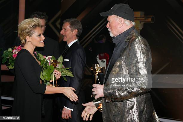 Helene Fischer and Mike Love of 'The Beach Boys' attend the Goldene Kamera 2016 show on February 6 2016 in Hamburg Germany