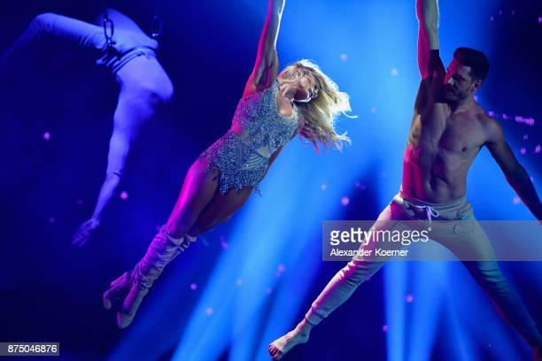 Helene Fischer and Thomas Seitel perform on stage during the Bambi Awards 2017 show at Stage Theater on November 16 2017 in Berlin Germany