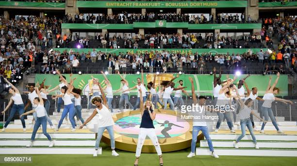 Helene Fischer performs during the half time of the DFB Cup Final 2017 between Eintracht Frankfurt and Borussia Dortmund at Olympiastadion on May 27...