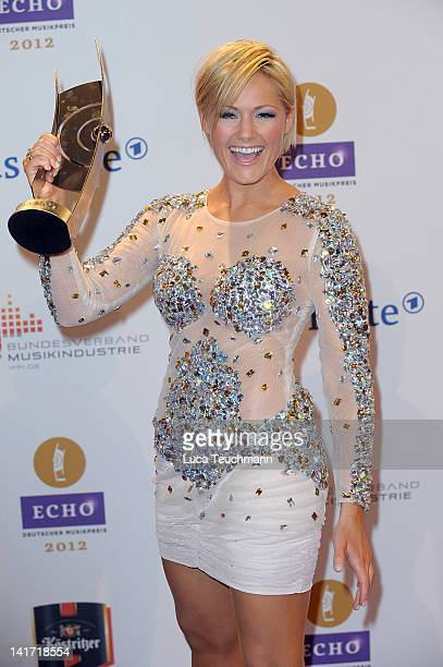 Helene Fischer poses with her award during the Echo award 2012 at Palais am Funkturm on March 22 2012 in Berlin Germany