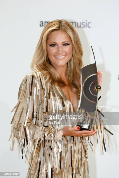 Helene Fischer poses with her award during the Echo Award winners board at Messe Berlin on April 12 2018 in Berlin Germany