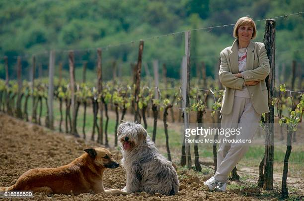 Helene Levieux owner of the Chateau LabatutBouchard winery with her two dogs The vineyard is located in the Bordeaux region