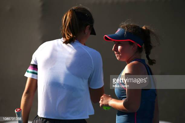 Helene Pellicano of Malta and Marta Custic of Spain talk tactics in their Junior's Doubles match against Leylah Annie Fernandez of Canada and Sasha...