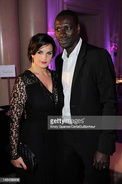 Helene Sy and Omar Sy attend the 'Global Gift Gala' hosted by jewel designer Sheeva at the Hotel George V on May 28 2012 in Paris France