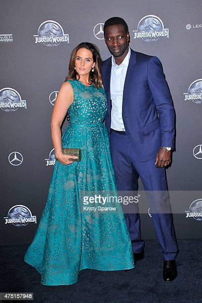 Helene Sy and Omar Sy attend the 'Jurassic World' Photocall at UGC Normandie on May 29 2015 in Paris France