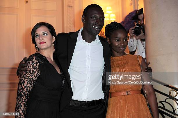 Helene Sy Omar Sy and Aissa Maiga attend the 'Global Gift Gala' hosted by jewel designer Sheeva at the Hotel George V on May 28 2012 in Paris France
