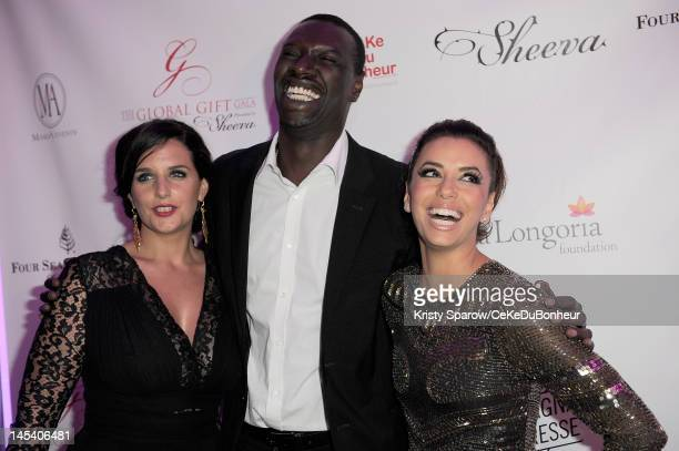 Helene Sy Omar Sy and Eva Longoria attend the 'Global Gift Gala' hosted by jewel designer Sheeva at the Hotel George V on May 28 2012 in Paris France
