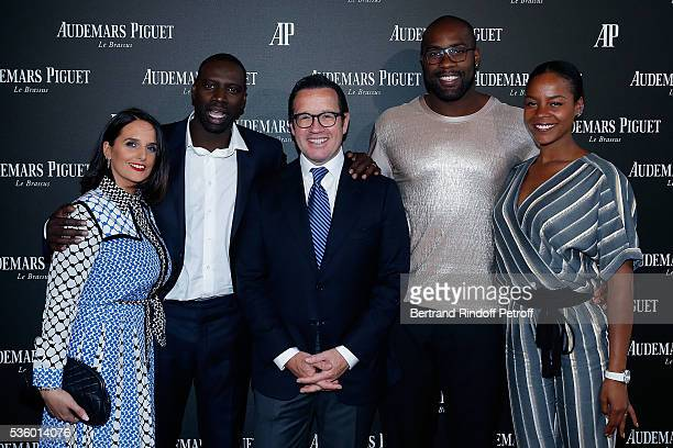 Helene Sy, Omar Sy, CEO of Audemars Piguet Francois Henry Bennahmias, Judoka Teddy Riner and his wife Luthna Plocus attend the Audemars Piguet Rue...