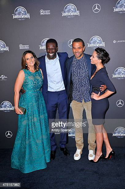 Helene Sy Omar Sy Tony Parker and Axelle Francine attend the 'Jurassic World' Photocall at UGC Normandie on May 29 2015 in Paris France