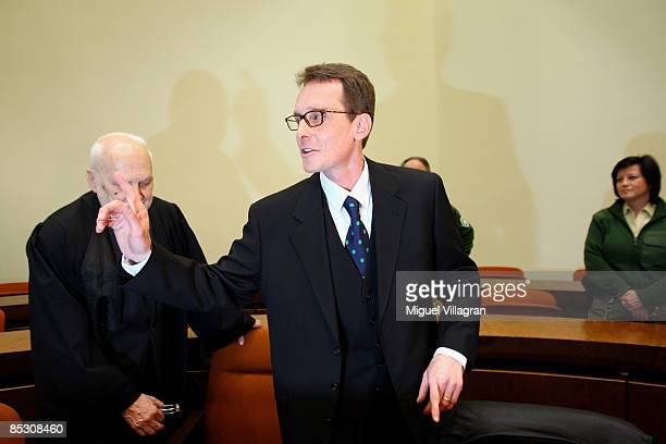 Helg Sgarbi and his German lawyer Egon Geis react prior to the verdict at the country court on March 9 2009 in Munich GermanySgarbi has been charged...