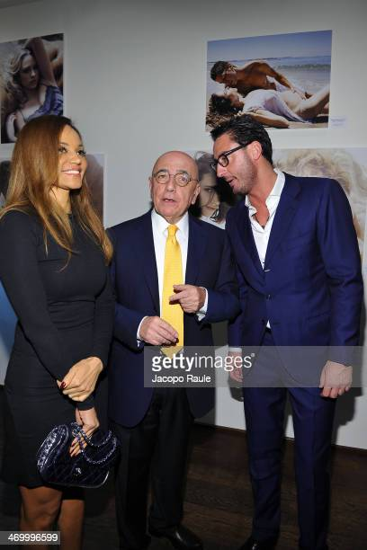 Helga Costa, Adriano Galliani and Lorenzo Tonetti attend 'The Faces' Opening Exhibition on February 17, 2014 in Milan, Italy.