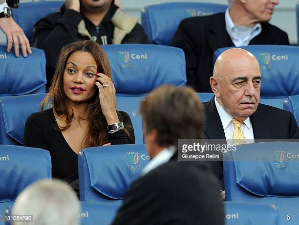 Helga Costa and Adriano Galliani of Milan during the Serie A match between AS Roma and AC Milan at Stadio Olimpico on October 29, 2011 in Rome, Italy.
