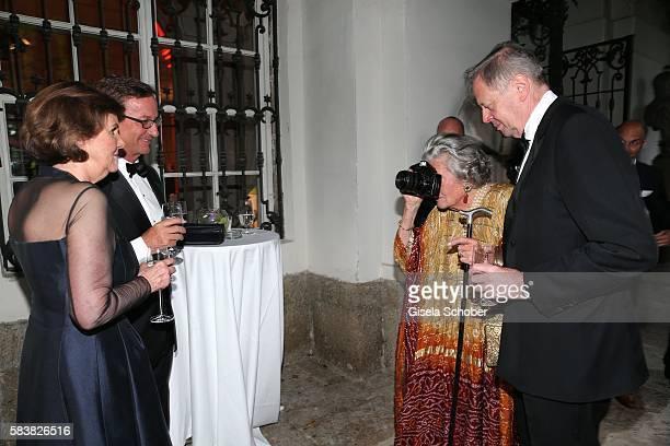 Helga RablStadler Thaddaeus Ropac Fuerstin 'Manni' Marianne SaynWittgensteinSayn SaynWittgenstein with camera photographs and her son Peter Prince zu...