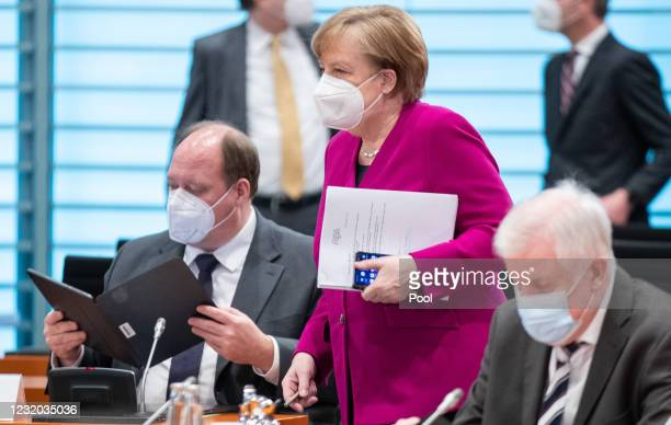 Helge Braun, Head of the Federal Chancellery, and German Chancellor Angela Merkel attend the Cabinet Meeting on March 31, 2021 in Berlin, Germany.